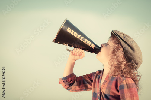 Kid shouting through vintage megaphone