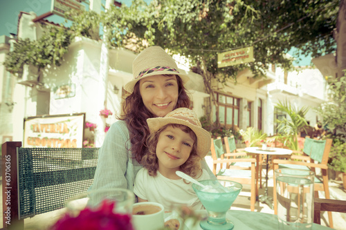 Mother with child in summer cafe