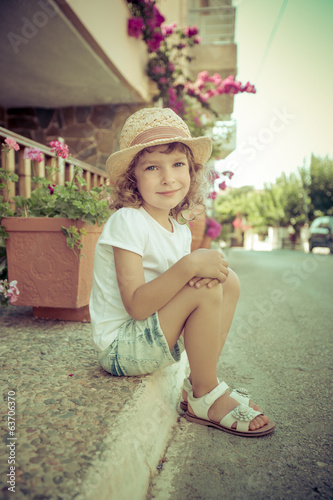 Child in summer city
