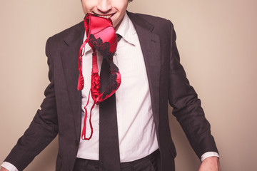 Businessman with bra in his mouth