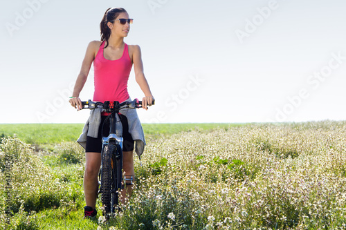 Fit woman riding mountain bike