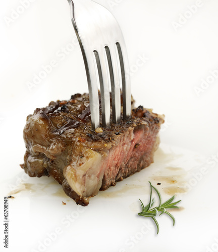 Piece Of Red  Meat Steak On A Fork
