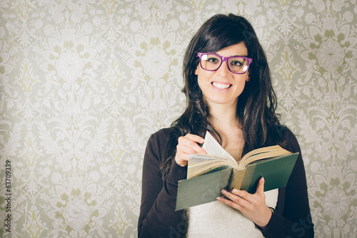 Retro woman reading old book