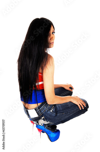 Girl crouching on floor.