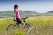 Fit woman riding mountain bike