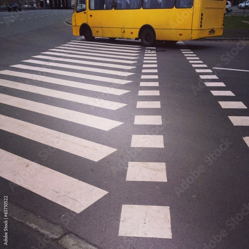 yellow bus on the crosswalk
