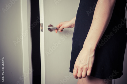 Woman opening a door to the unknown