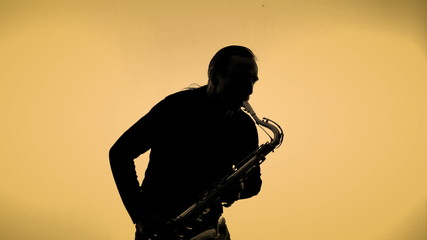 Saxophone player in a color background