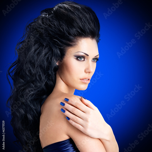 Face of a sexy woman  with blue nails