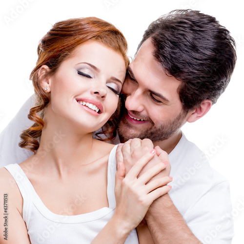 Closeup portrait of beautiful smiling couple.
