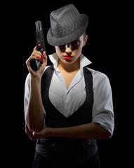 Woman with gun on black