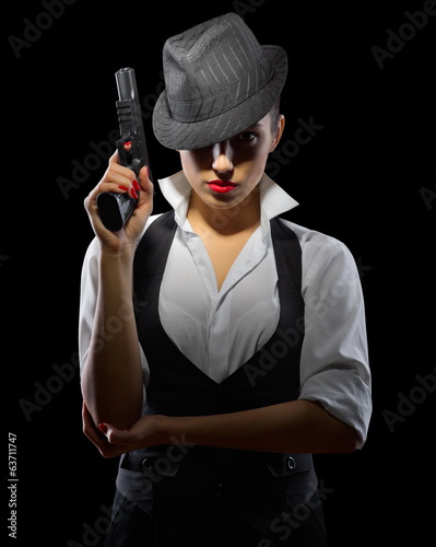 Woman with gun on black