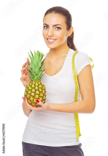 Young girl with pineapple