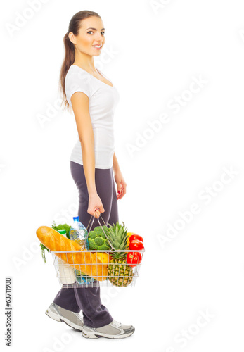 Young girl with full food basket