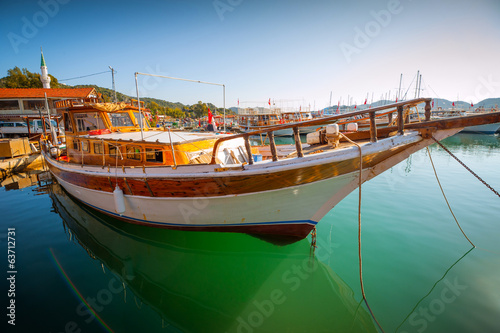 Tourism in the Mediterranean. Boat in the bay