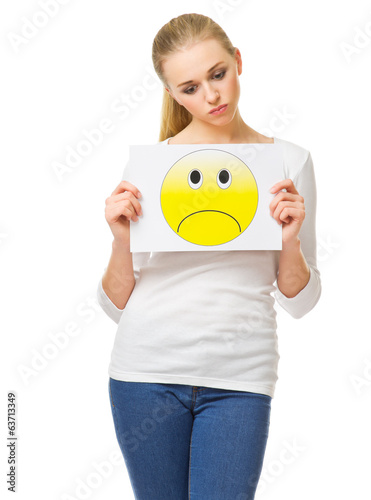 Young woman with sad banner