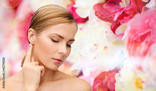 canvas print picture calm woman touching her ear