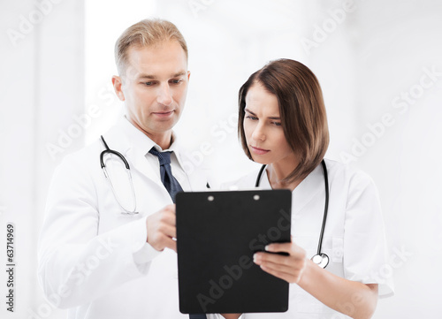 two doctors writing prescription