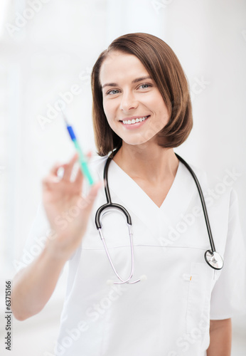 female doctor holding syringe with injection