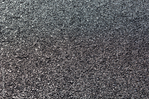 close-up horizontal view of new asphalt road