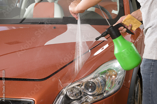 Applying nano coating on orange car