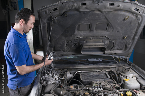 Car Repairman at Garage