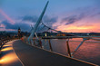 Sunset over Peace Bridge of Derry, Northern Ireland - 63715763
