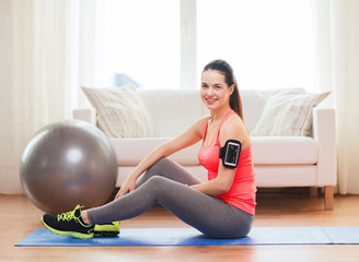 smiling girl with armband execising at home