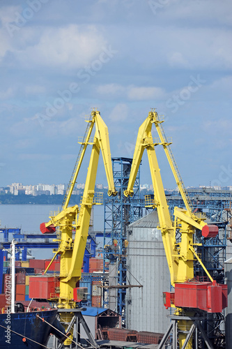 Cargo crane, ship and grain dryer in port Odessa, Ukraine