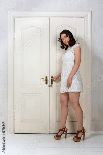 girl opens the door