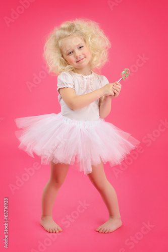 little girl with candy on pink background skirt tutu