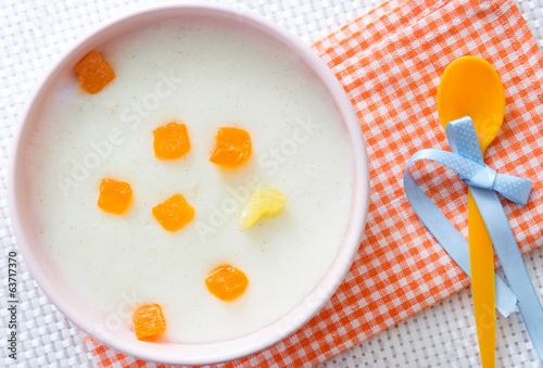 Baby food.Milk porridge with fruits.
