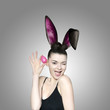 Beautiful young brunette woman as easter bunny