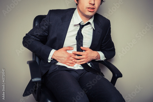 Businessman with stomach pain
