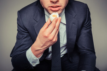 Businessman eating egg