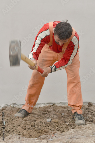 portrait of workman with sledge hammer
