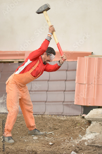 man with sledge hammer