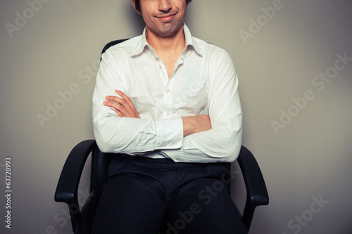 Casual young businessman in office chair