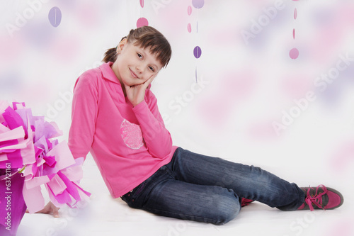 Smiling teenage girl sitting