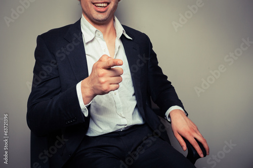 Happy businessman laughing and pointing