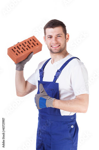 Builder with brick in hand
