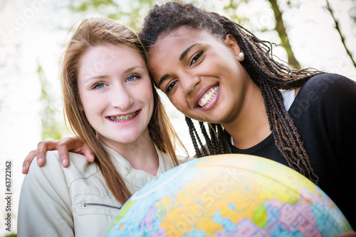 Multiracial Couple of friends Holding Globe Map