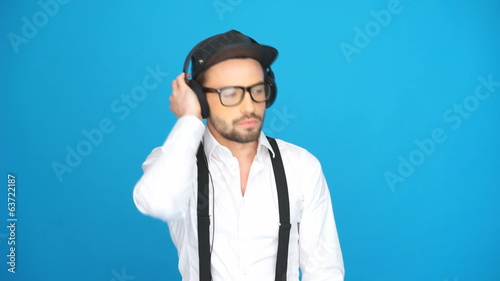 man wearing hat and headphones listening to the music