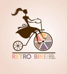 Girl on a bicycle. Retro bike.