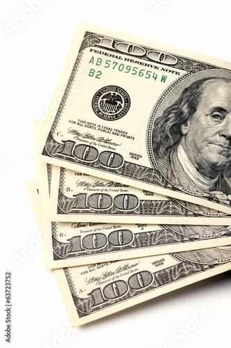 Stack of one hundred dollars. Isolated on white background