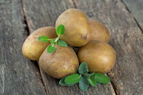new potatoes on a wooden surface
