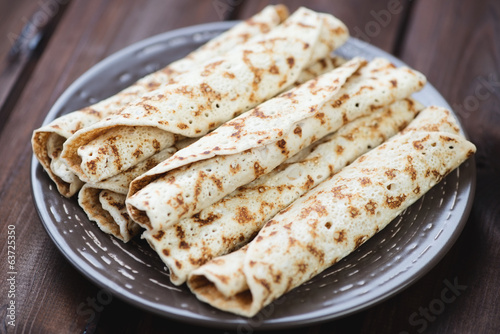 Freshly made rolled crepes with stuffing, close-up, studio shot