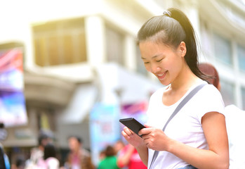 woman use smart phone at street