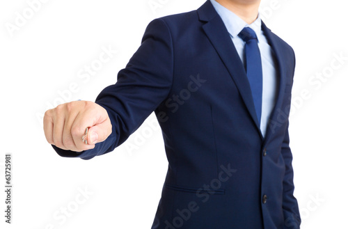 Businessman holding key for unlock