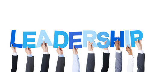 Business People Holding the Word Leadership